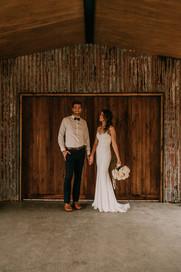 Couple in front of Barn Doors