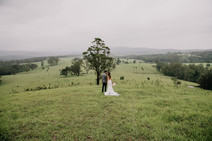 Bride and Groom Kissing with a View