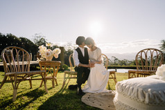 Couple Sitting on the Lawn