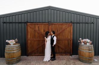 Couple Infront Of Barn Doors