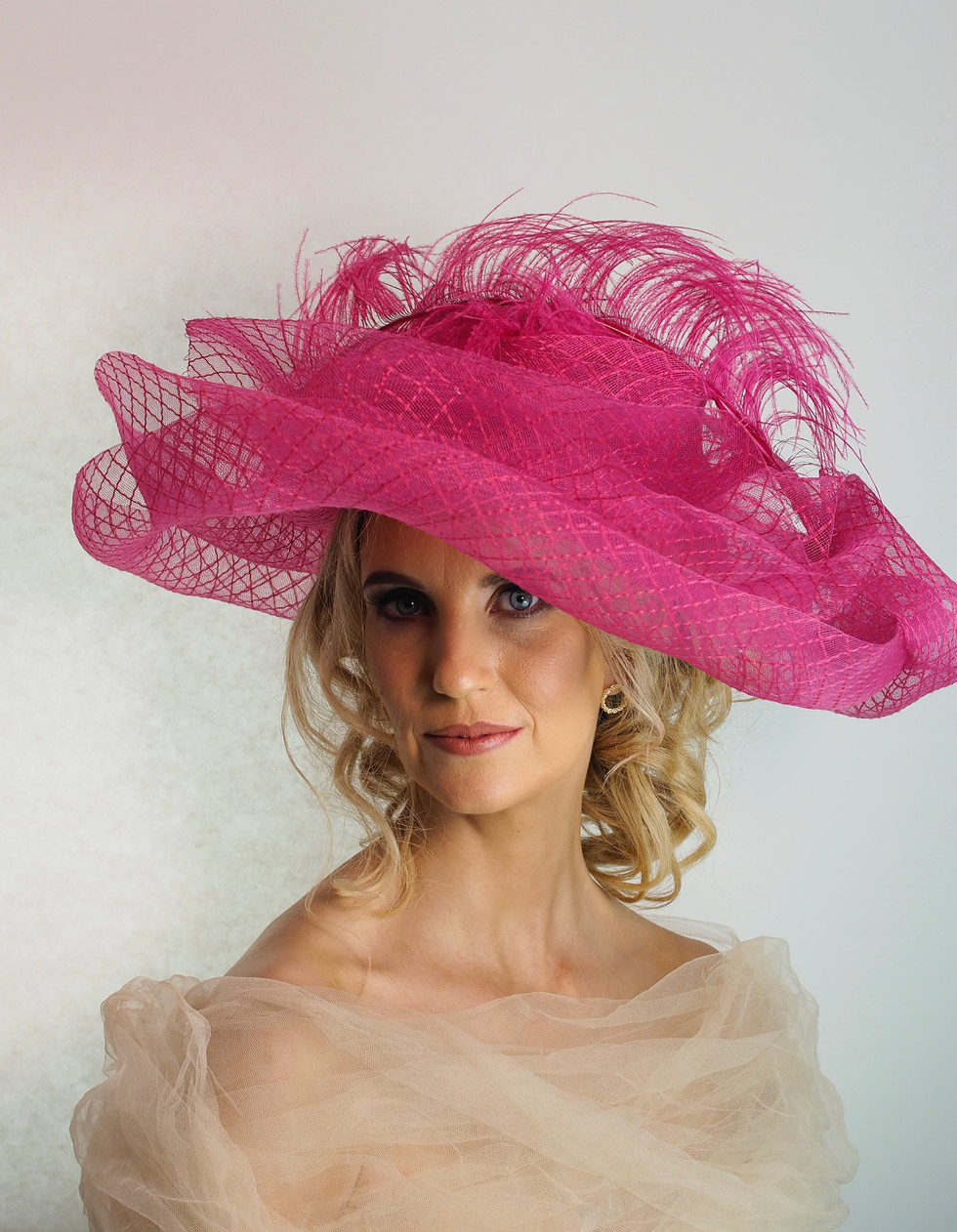 Large Pink Hat With Feather Trim.jpeg