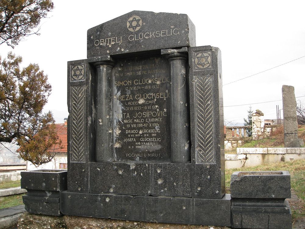 Jewish tombstone riddled with bullet holes at a cemetary that served as a dividing line between Serb and Bosnian forces.