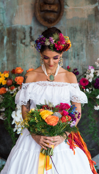 Bride holding a bouquet at a Cinco de Mayo Wedding photoshoot at MyMoon