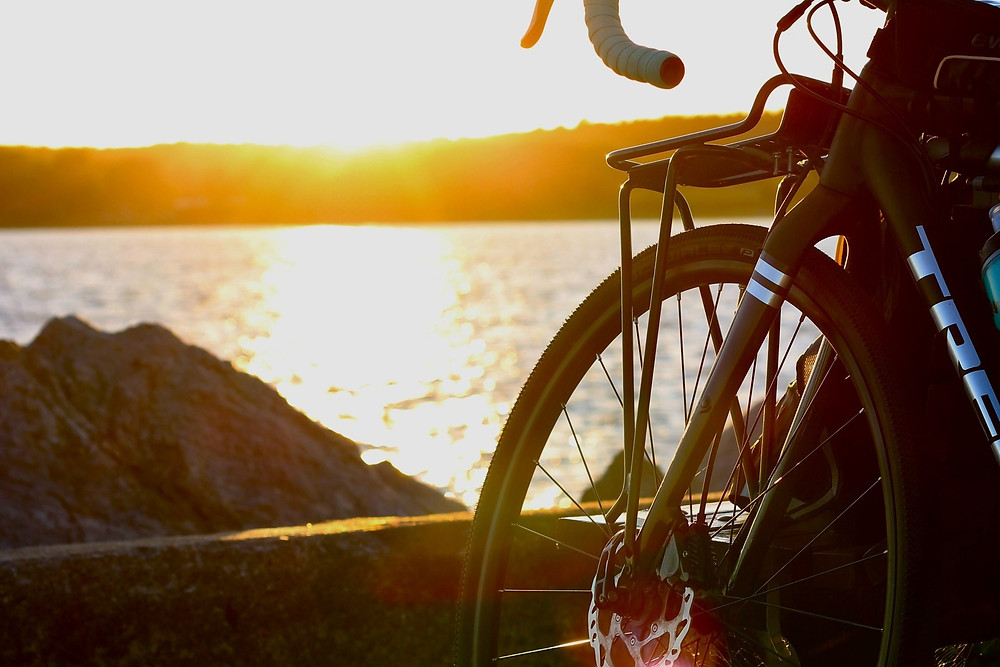 Bike by water in sunset