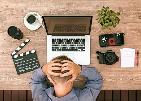 entrepreneur at desk young stressed_edit