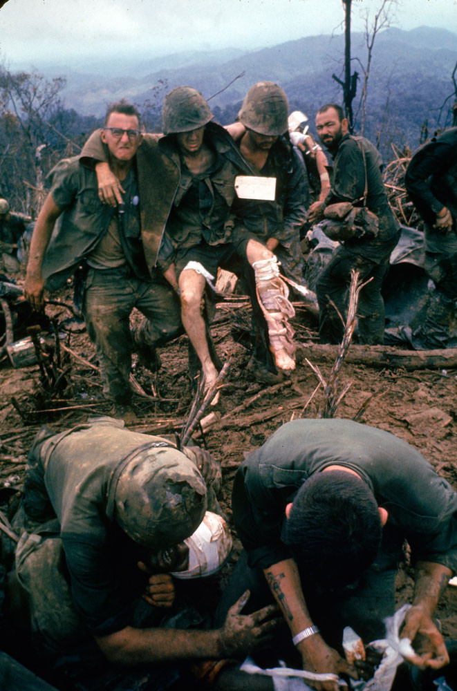 American Marines aid wounded comrades during Operation Prairie near the DMZ during the Vietnam War, October 1966.  Source: Larry Burrows, Life Pictures/Getty Images