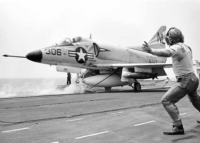 A catapult crew of carrier Ranger (CVA 61) readies an A-4 Skyhawk attack plane for a March 1965 bombing mission in North Vietnam.  Source: Naval History and Heritage Command