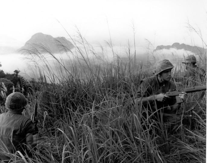Marines of I Company, 3rd Battalion, 3rd Regiment, patrol a hill near the Rock Pile (seen in the background) during Operation Prairie.  Source: VA020896, Brigadier General Edwin H. Simmons Collection, The Vietnam Center and Sam Johnson Vietnam Archive, Texas Tech University