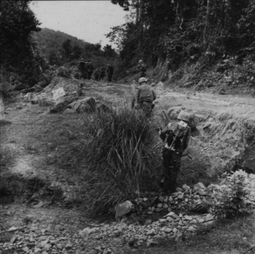 "Marines from ""L"" Company, 3rd Battalion, 1st Regiment moving along a trail during Operation Double Eagle."