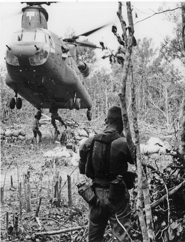 CH-47 helicopter. Operation Manhattan - aerial delivery transporting rice. Cu Chi, Vietnam.  Source: VA058620, U.S. Army Aviation Museum Volunteer Archivists Collection, The Vietnam Center and Sam Johnson Vietnam Archive, Texas Tech University