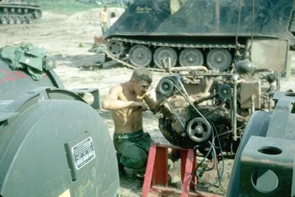 Dau Tieng, Vietnam. Operation Manhattan. SP5 Varsel changing an M113 APC transmission.  Source: VAS048243, Philip Varsel Collection, The Vietnam Center and Sam Johnson Vietnam Archive, Texas Tech University
