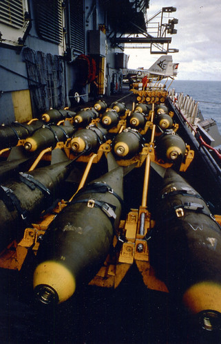"General purpose, or ""iron bombs,"" crowd the deck before ordnancemen of aircraft carrier Ranger (CVA 61) load them onto Seventh Fleet attack planes.  Source: Naval History and Heritage Command"