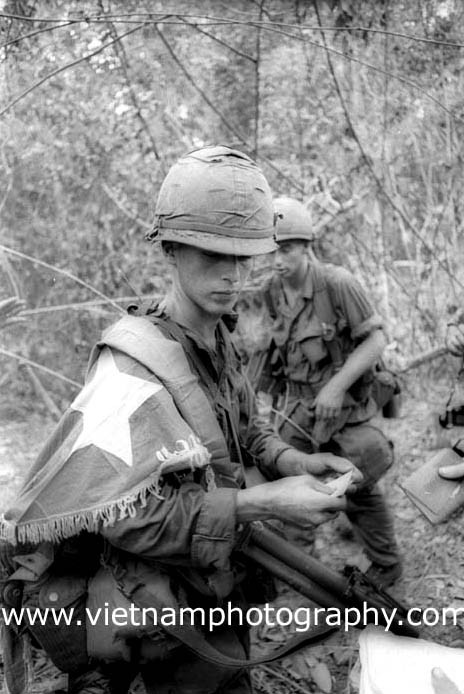 Soldiers from the 1st Infantry Division searched a Viet Cong (VC) base camp. Among the things they captured was this flag. The action took place near Quần Lợi, July 10, 1966.  Used with permission of the photographer.