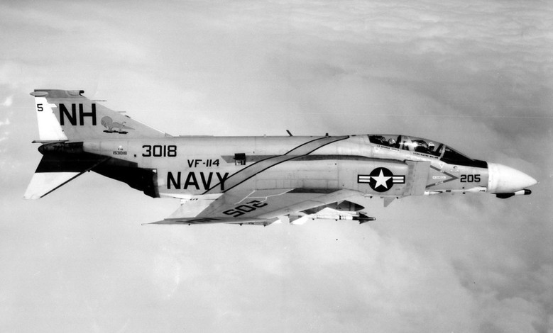 A Kitty Hawk (CVA 63) F-4B Phantom of Fighter Squadron 114 flies high above the clouds of North Vietnam during Rolling Thunder. The Phantom's Sparrow radar-guided and Sidewinder heat-seeking missiles claimed many enemy fighters.  Source: Naval History and Heritage Command