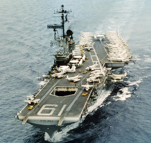 Combat veteran Hancock (CVA 19), one of many Seventh Fleet carriers used to bomb Communist forces in North Vietnam during the Rolling Thunder bombing campaign, steam through the Western Pacific.  Source: Naval History and Heritage Command
