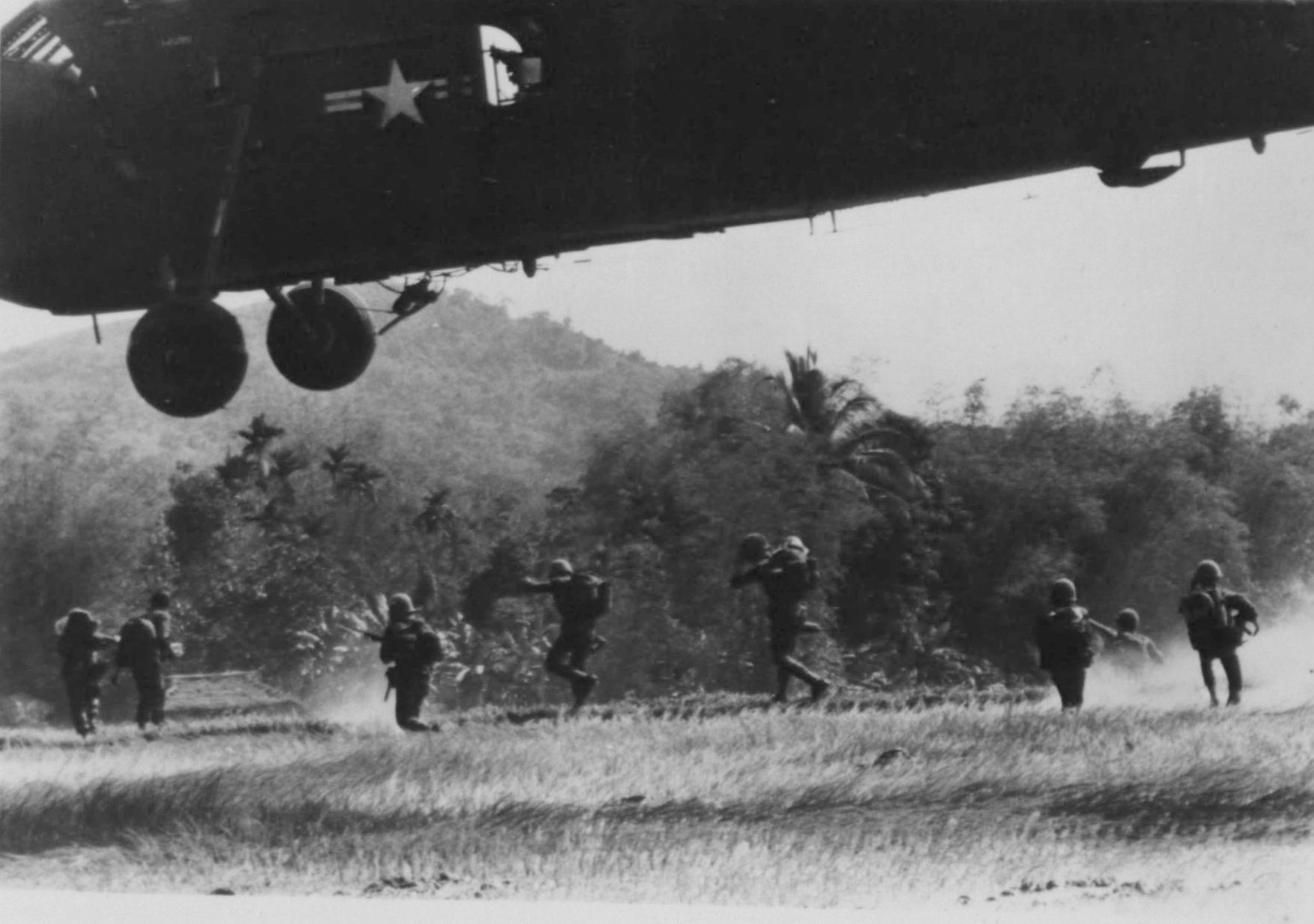 Viet Cong hunt--Marine riflemen spread out searching for Viet Cong during Operation Double Eagle II. Helo's from Marine Medium Helicopter Squadron (HMM)-263, lift off after bringing the Marines into the battle area.