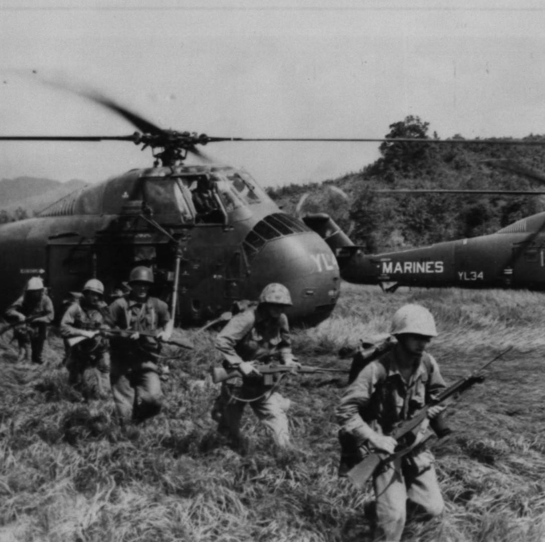 On the move--Marine riflemen move out from helicopters in the area of Operation Double Eagle. The ground Marines were brought into the landing zone (LZ) by 'copters from Marine Aircraft Group (MAG)-36. The operation took place approximately 35 miles south of Chu Lai.
