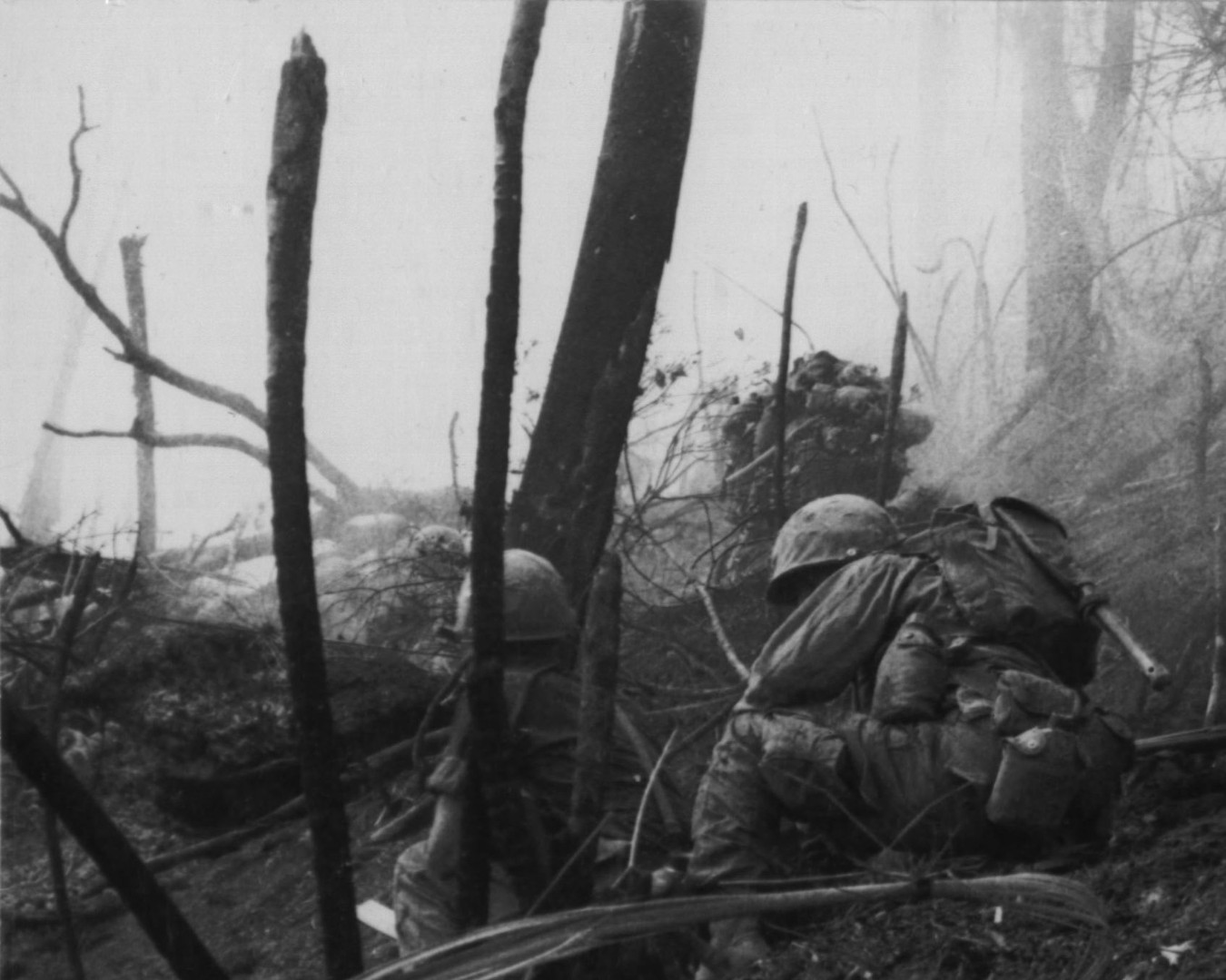 30SEP66. Operation Prairie--Marines of M Company, 3rd Battalion, 4th Marine Regiment, come under grenade attack while taking Hill 484 near the demilitarized zone.  Source: National Archives photo no. 26387371