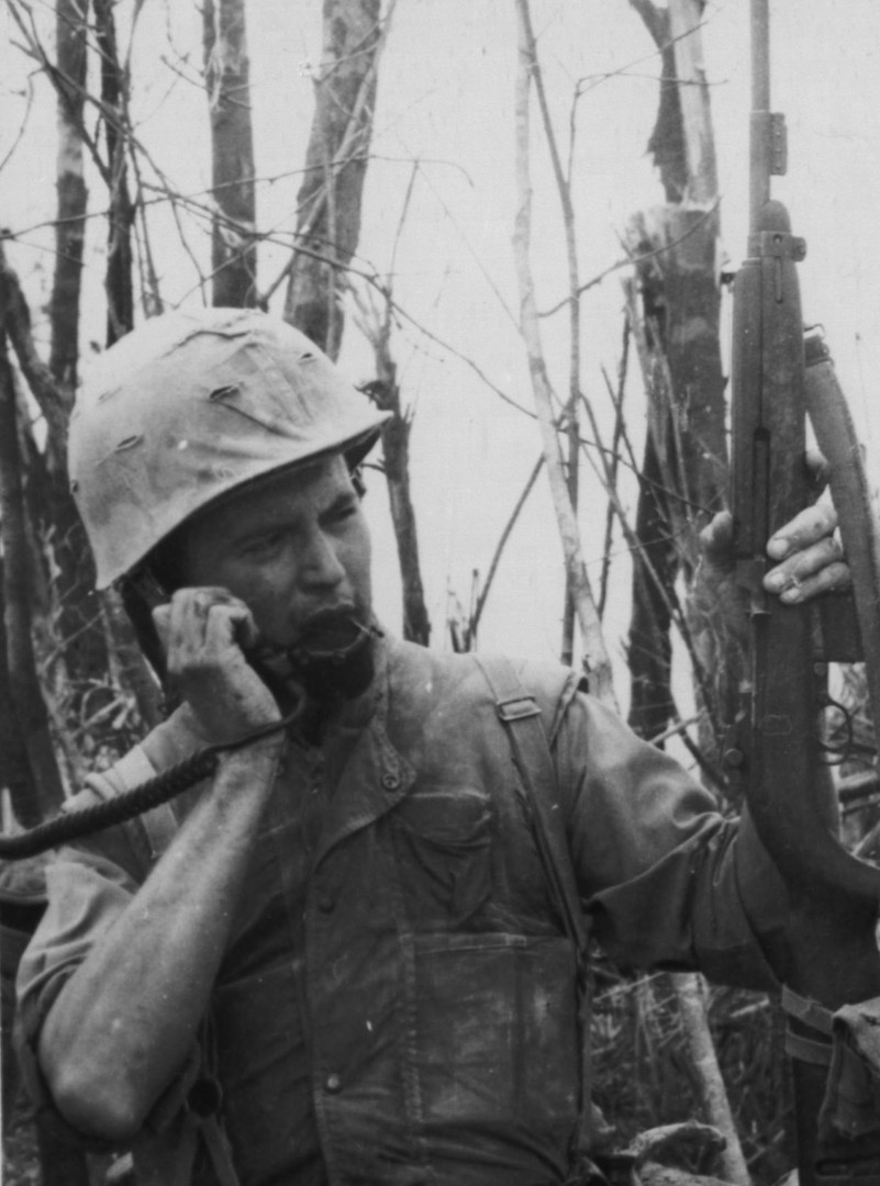 30SEP66. First Lieutenant Edward J. Crowell (Lincoln, R.I.) is the commanding officer of M Company, 3rd Battalion, 4th Marine Regiment. Lt. Crowell is talking to the battalion commanding officer on the phone after taking Hill 484, during Operation Prairie near the demilitarized zone.  Source: National Archives photo no. 26387365