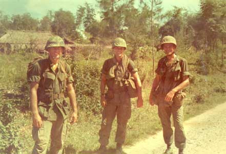 Capt. Strichker, Lt. Dunnigan, and Father Capadonno before the beginning of Swift. Capodanno was killed during the operation.  Source: Photo from JD Murray