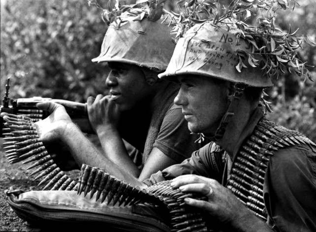 Two U.S. Marines from 3rd Battalion, 5th Regiment, 1st Marine Division open fire during Operation Swift in September 1967 in South Vietnam. The Marines were searching for the 2nd North Vietnamese Army Division in the Ky Son Valley, south of Da Nang.  Source: John Olson, Stars and Stripes