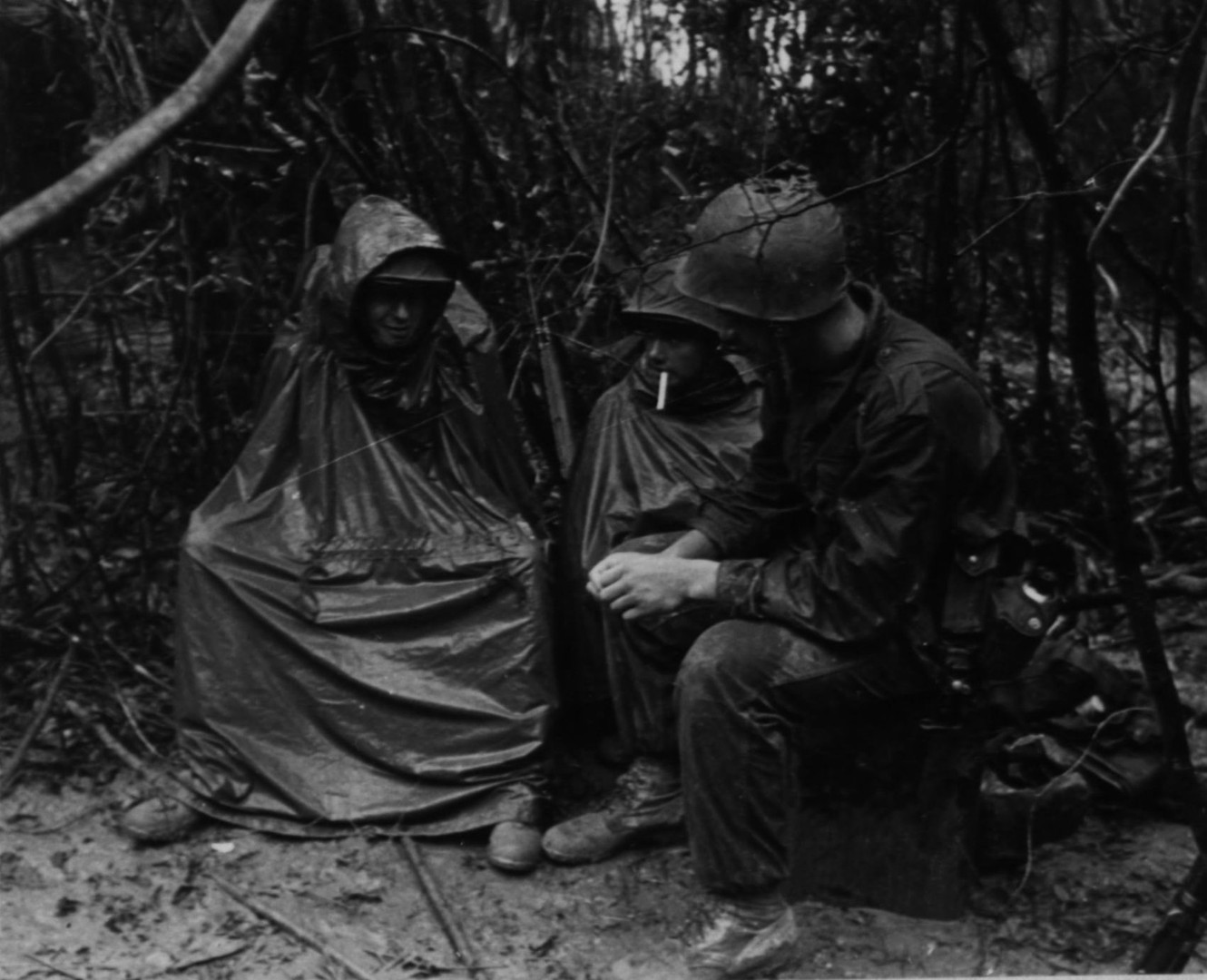 27NOV66. Men of M Company, 3rd Battalion, 3rd Regiment, have a smoking  break and chat while on Operation Prairie near the demilitarized zone.  Source: National Archives photo no. 26387391