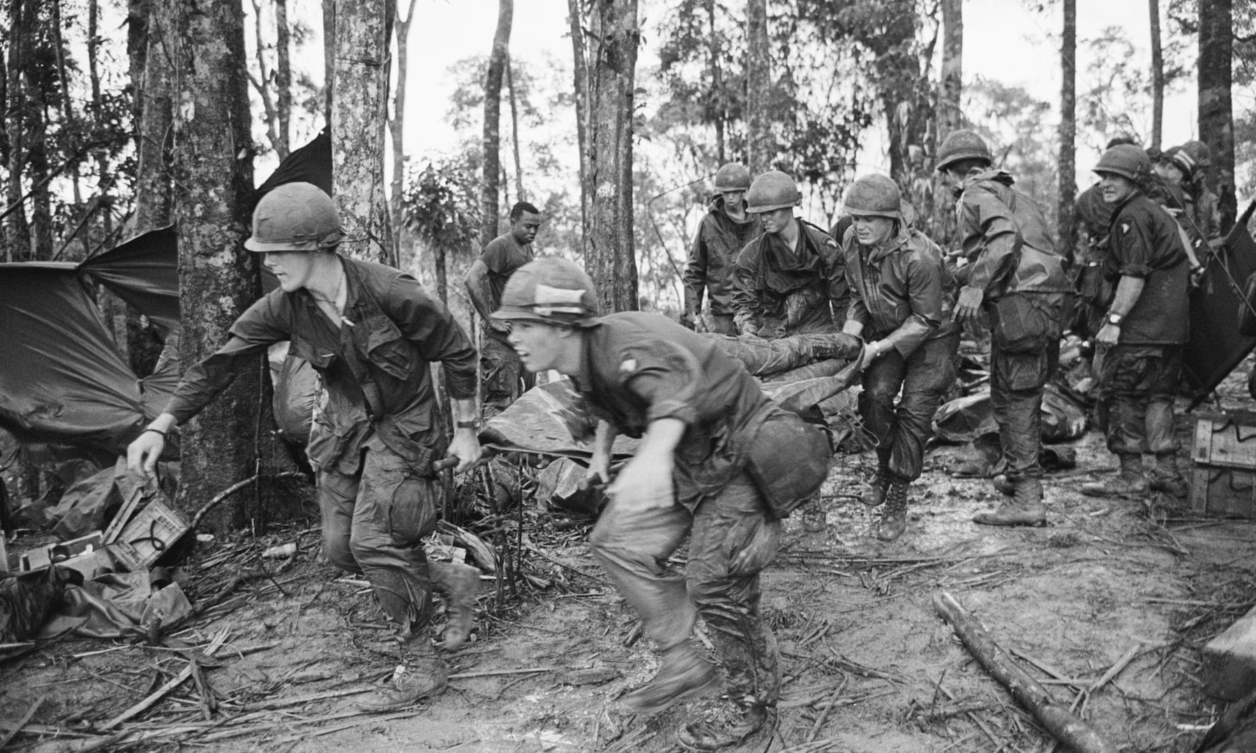 A quartet of U.S. 101st Air Division troopers keep low as they rush a stretcher-borne wounded comrade to a medical aid station during the battle for Hamburger Hill.   Source: Corbis, Bettman Archive