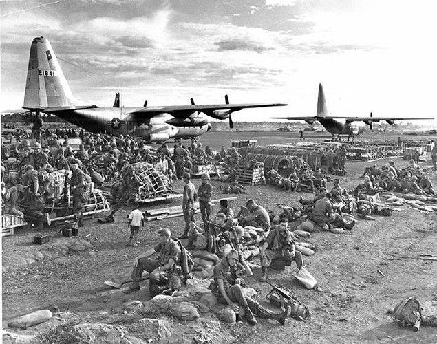 Air Force Provides Operation Cedar Falls Airlift: Saigon, Battle Zone Delivery - An Air Force C-130 Hercules unloads U.S. Army combat troops at Dau Tien during the airlift phase of Operation Cedar Falls on Jan. 7 [1967]. The C-130s airlifted elements of the First Infantry Division including troops, cargo and rolling stock, to three forward airstrips. The search and destroy mission made immediate contact with the Viet Cong.  Source: VA061455, George H. Kelling Collection, The Vietnam Center and Sam Johnson Vietnam Archive, Texas Tech University
