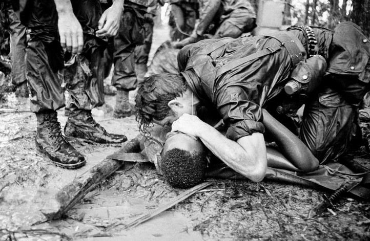 A trooper of the 101st Airborne Division attempts to save the life of a buddy at Dong Ap Bia Mountain, near South Vietnam's A Shau Valley on May 19, 1969. The man was seriously wounded in the last of repeated attempts by U.S. forces to capture enemy positions there.   Source: Hugh Van Es, AP Photo