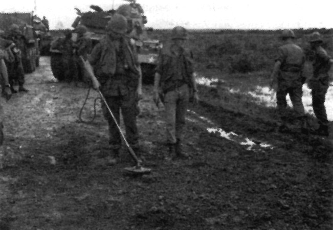 Sweeping for mines along Highway 13 during Operation El Paso II.