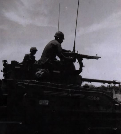 SP/4 Frank Valdez, (San Diego, Calif), Gunner, B Battery, 4th Bn, 60th Arty, 173rd Abn Bde, stands by his M-60 Machine Gun during a crew drill for Operation Greely. 15 July 1967.