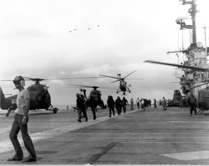 Aboard the LPH Valley Forge, Marines of the 2nd Battalion, 3rd Regiment, board choppers for a lift to the landing site.