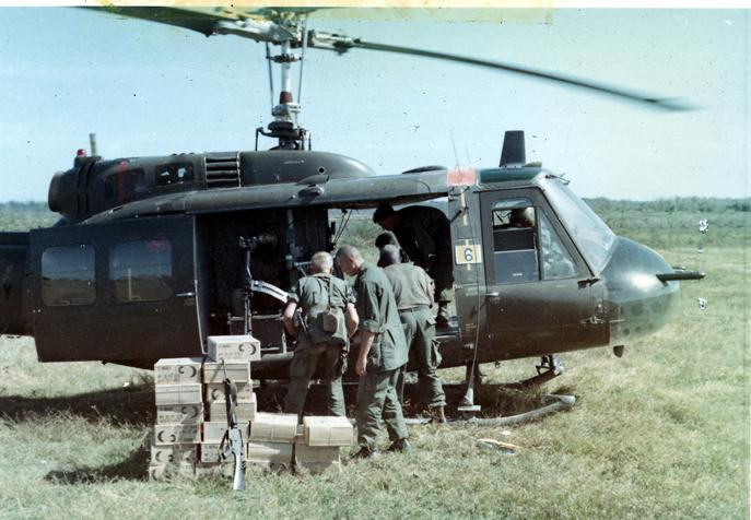 The mission of C Company, 1st Battalion, 5th Mechanized Infantry, 2nd Brigade, 25th Infantry Division was to sweep through the Filhol Plantation in search of fleeing Viet Cong units. Cases of C-rations are off loaded from a UH1D helicopter.  Source: VA029814, Robert Lafoon Collection, The Vietnam Center and Sam Johnson Vietnam Archive, Texas Tech University