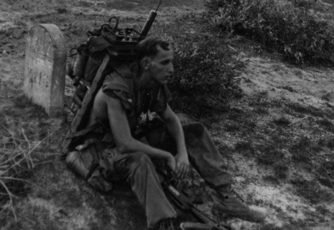 Taking a break--LCpl P.J. Ferguson (Indianapolis, Ind.), a member of the forward air control team attached to Second Battalion, Fifth Marines Regiment, First Marine Division takes a break during Operation Swift, a search and destroy operation conducted south of Da Nang.  Source: National Archives photo no. 26387639
