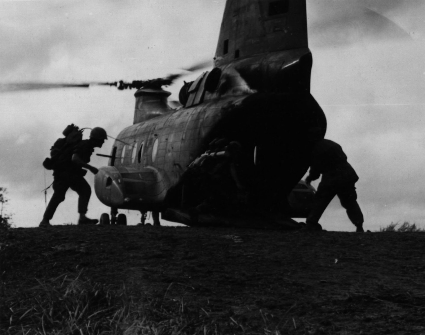 27NOV66. Troops of M Company, 3rd Battalion, 3rd Marine Regiment, prepare to embark aboard a helicopter during a sweep on Operation Prairie near the demilitarized zone.  Source: National Archives photo no. 26387367