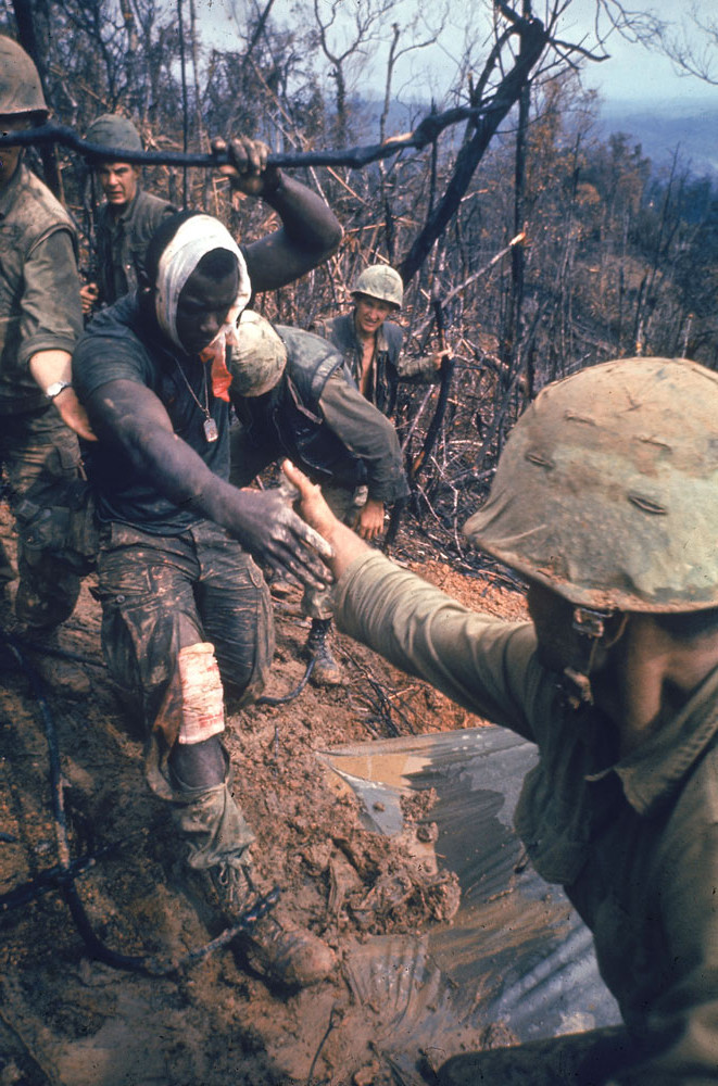 American Marines aid a wounded comrade during Operation Prairie near the DMZ during the Vietnam War, October 1966.  Source: Larry Burrows, Life Pictures/Getty Images