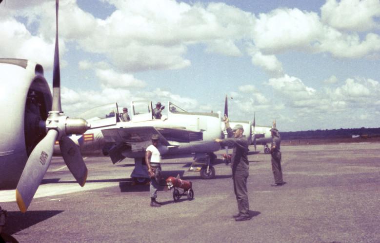 US Air Force armen train South Vietnam pilots, Bien Hoa Air Base, 1961.  Source: US Air Force