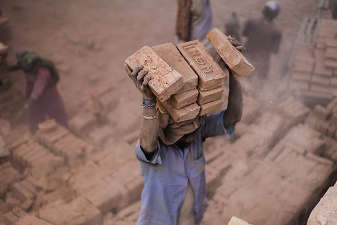 Person carrying bricks