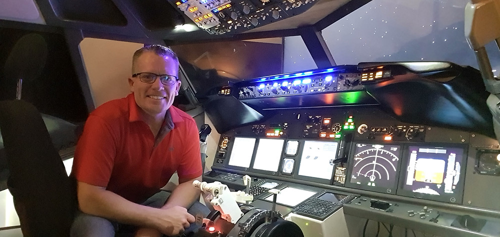 Karl looking smug with his hard work in the 737 sim cockpit