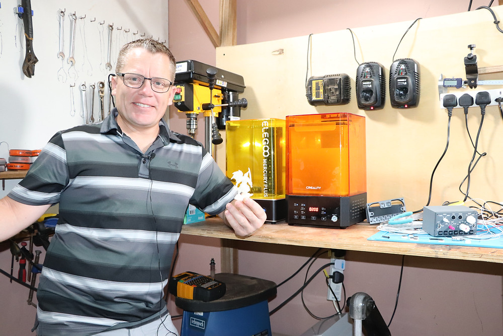 Karl from 737DIYSIM next to his resin printers and wash station