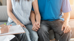 Patient couple having doctor or psycholo