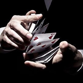 magician-shuffling-cards-cool-way-spotlight_edited_edited.jpg