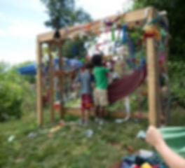 boys work on collaborative string art