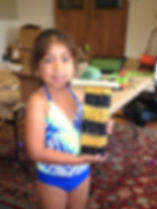 girl holds bee hotel she made