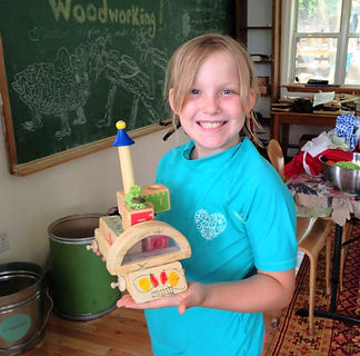 girl holds woodworking creation