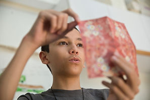 boy demonstrates origami