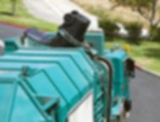 Municipal robotic arm trash truck dumps