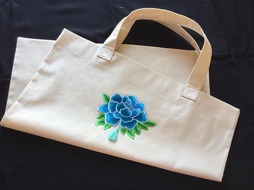 Tote with blue embroidered lotus embellishment