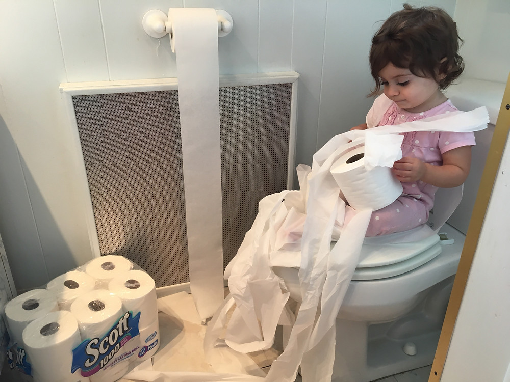 Baby playing with Toilet Paper