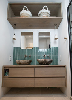 His and her stone washbasins